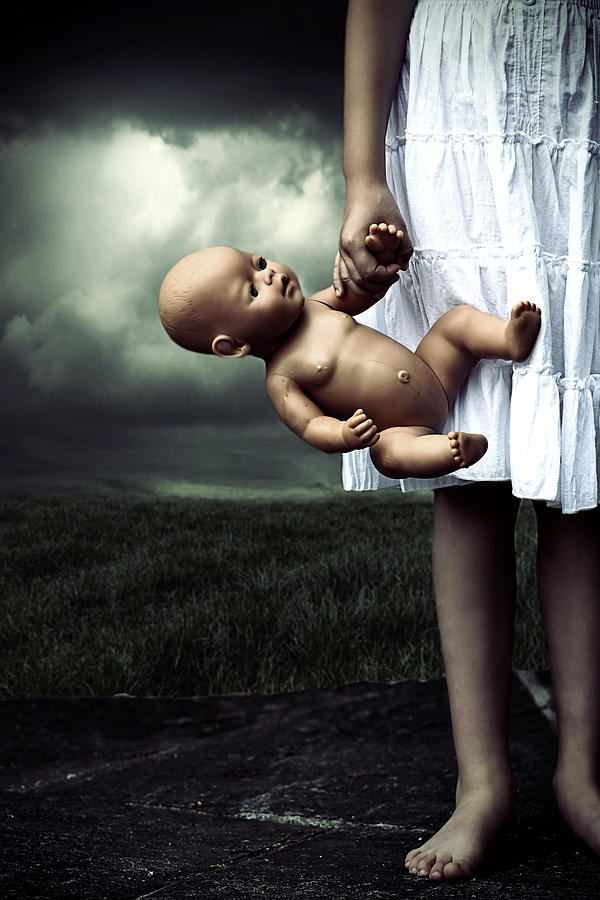 Girl With A Baby Doll Photograph