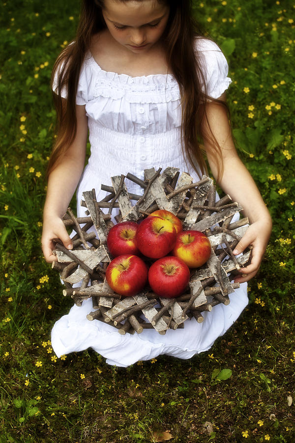 Girl With Apples Photograph