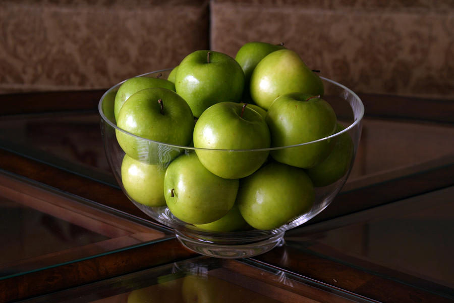 Glass Bowl Of Green Apples  Photograph