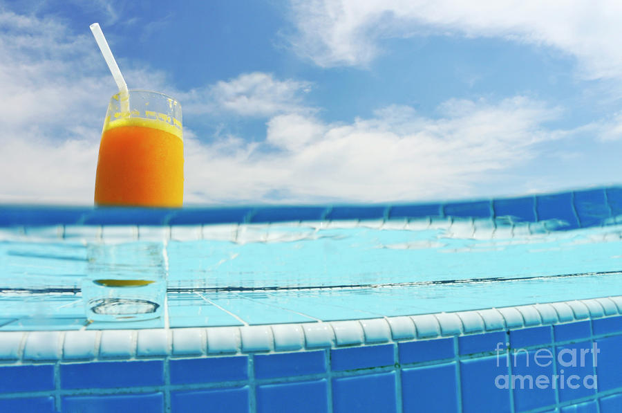 Glass Of Orange Juice On Pool Ledge Photograph  - Glass Of Orange Juice On Pool Ledge Fine Art Print