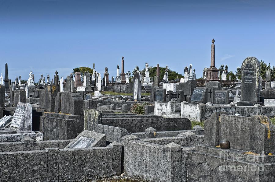 Gravestones In Graveyard Photograph