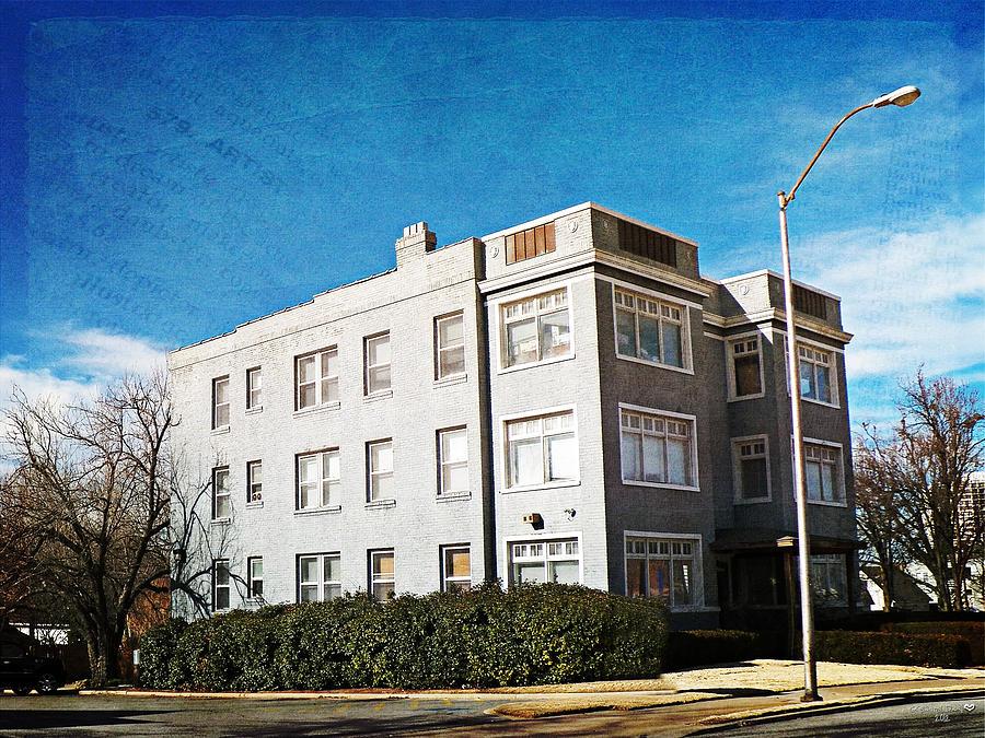 gray brick apartment building by linda deal