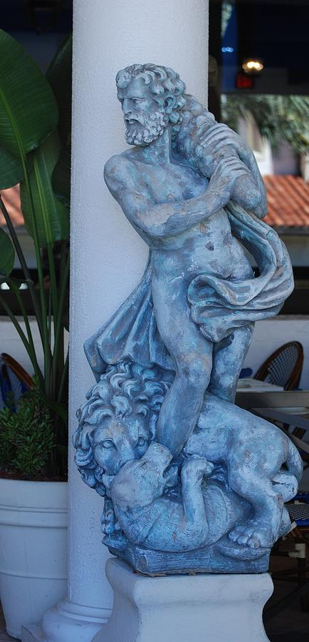 Greek Dude And Lion In Blue Sculpture