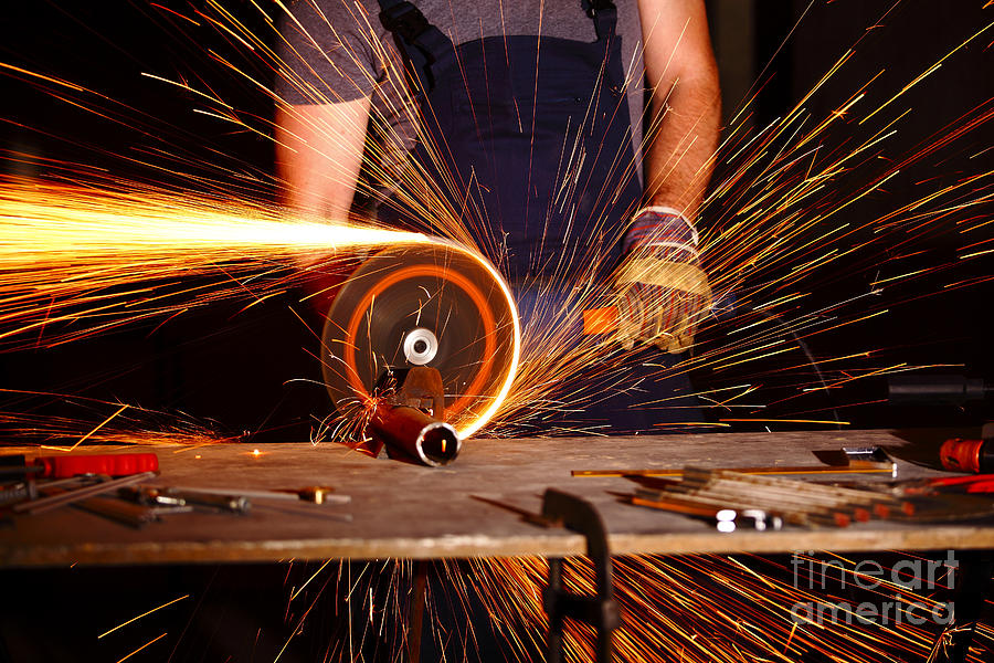 Background Photograph - Grinder In Action by Gualtiero Boffi