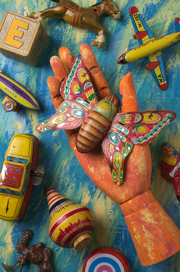 Hand Holding Butterfly Toy Photograph