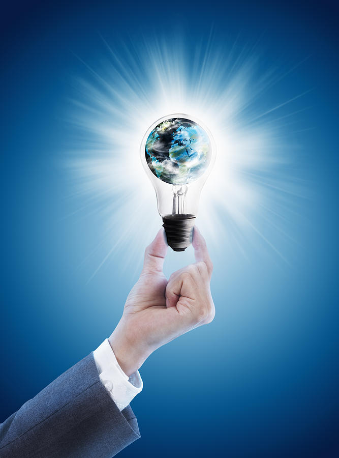 Hand Holding Light Bulb With Globe Photograph