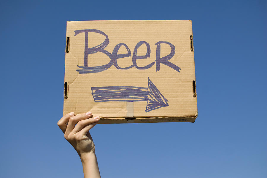 Hand Holding Up Makeshift beer Sign Photograph  - Hand Holding Up Makeshift beer Sign Fine Art Print