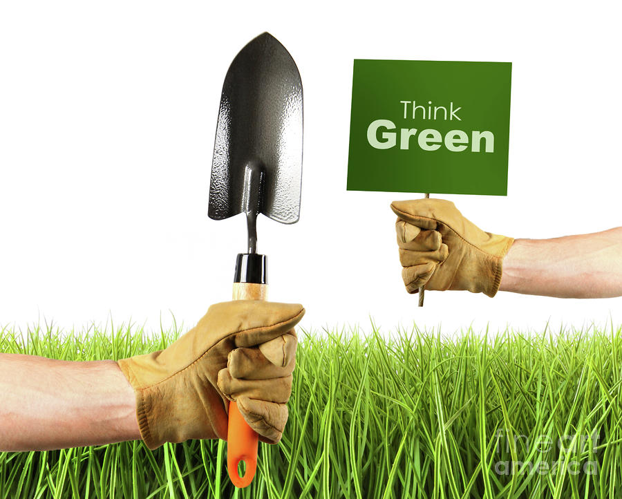 Hands Holding Garden Trowel And Sign Photograph