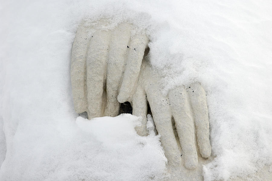 Hands Of A Statue Covered With Snow Photograph