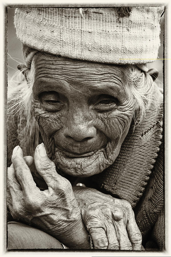 80-90 Yrs; Aborigine; Age; Aging; Art; Asia; Asian; Awe; Banaue; Close-up; Contemplation; Decor; Decoration; Detail; Fine Art; Glisten; Ifugao; Ifugao Province; Indian; Inspirational; Journey; Life; Loneliness; Female; Woman; Memory; Milestone; Native; Old; One; Philippines; Photographic; Photography; Portrait; Reflection; Reverence; Spirituality; Toned; Toned Black And White; Tranquility; Travel Destinations; Tribal; Vertical; Weathered; World Heritage Sight; Worn; Wrinkled; Zen Photograph - Hands Of Time by Skip Nall