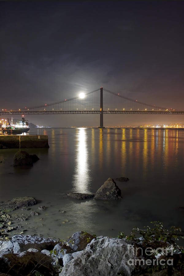 Harvest Moon Sets Over The Tagus River Photograph