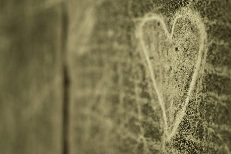 Heart Engraved On A Wall Photograph