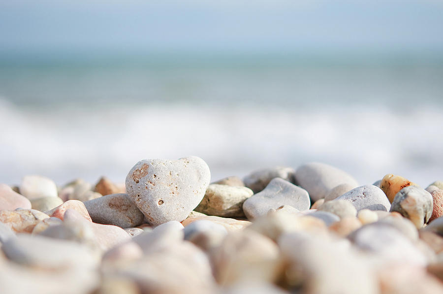 Heart Shaped Pebble On The Beach Photograph