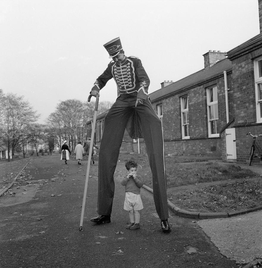 Child Photograph - Henry The Stilt Man by John Drysdale