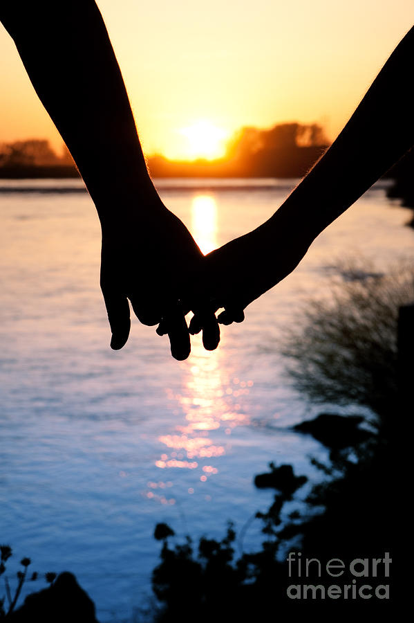 Silhouette couple holding hands