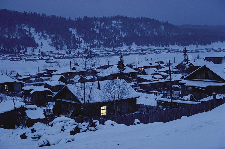 Photograph - Houses In The Snow At Dusk by Dean Conger