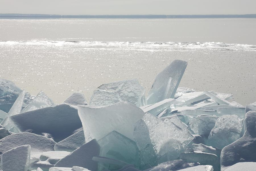 Ice Chunks On The Shores Of Lake Photograph