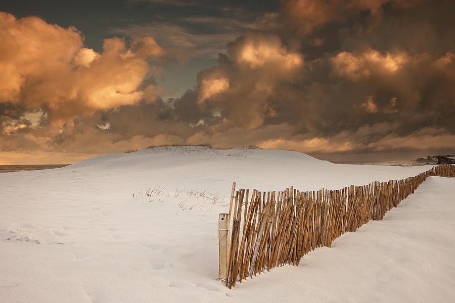 Illuminated Clouds Glowing Over A Snow Photograph