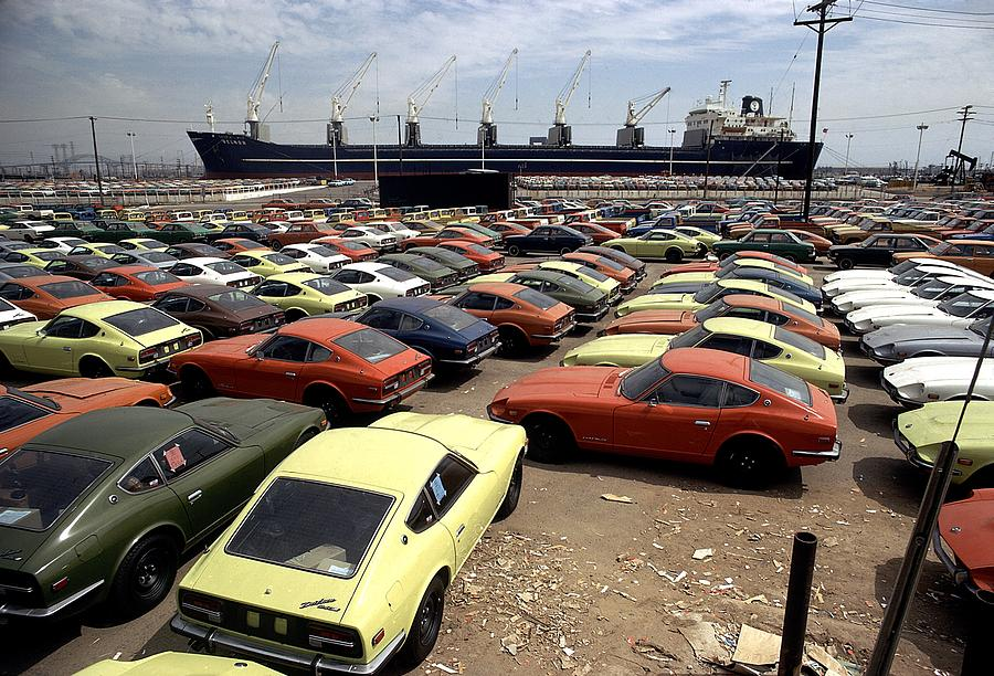 Imported Japanese Cars On The Pier Photograph by Everett