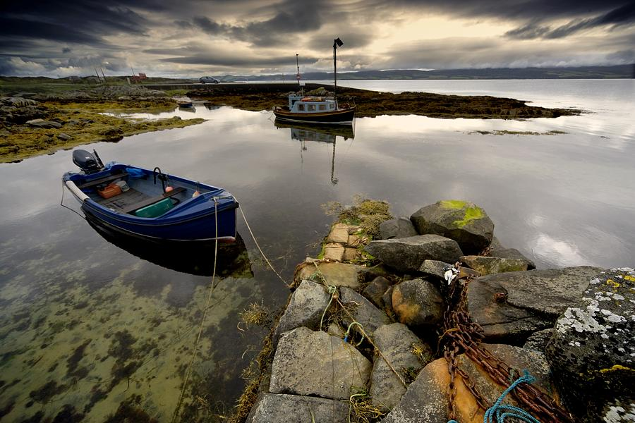 Short Photograph - Islay, Scotland Two Boats Anchored By A by John Short