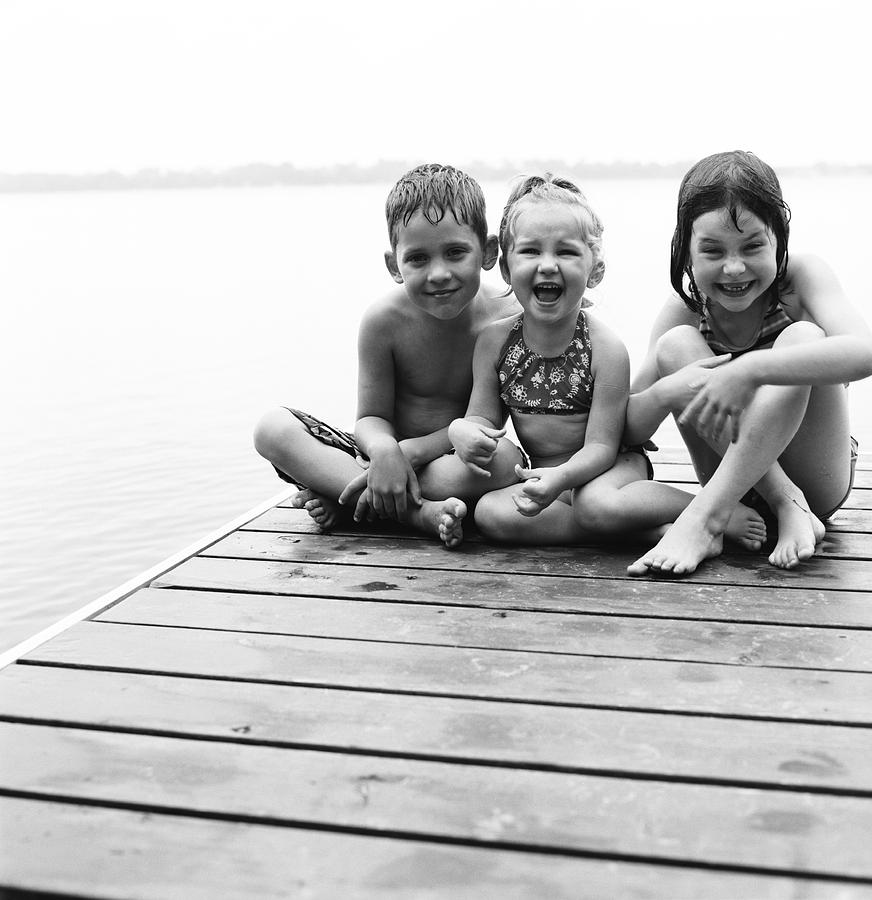 Kids Sitting On Dock Photograph  - Kids Sitting On Dock Fine Art Print