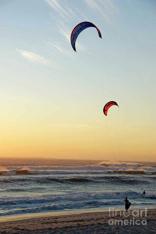 Kite Surfers On Beach At Sunset Photograph