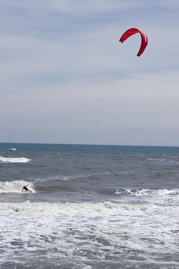 Kiteboarder With Kite In The Waves Photograph