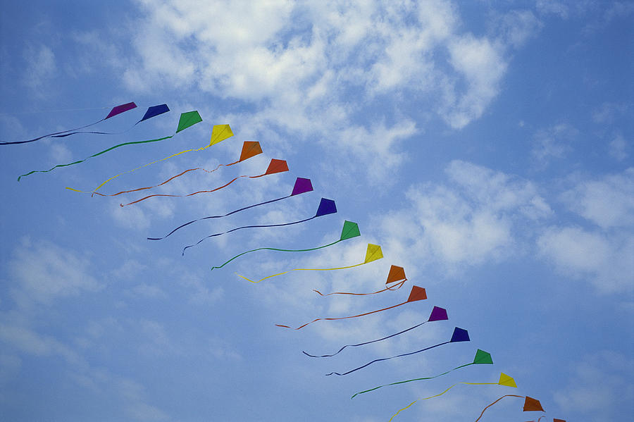 Kites Fly In A Rainbow Of Colors Photograph