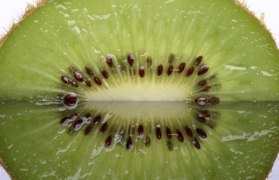 Kiwi Fruit Reflected On Glass Photograph