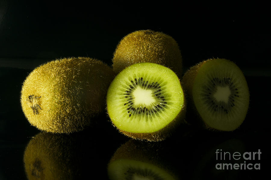 Kiwi In Black Background Photograph