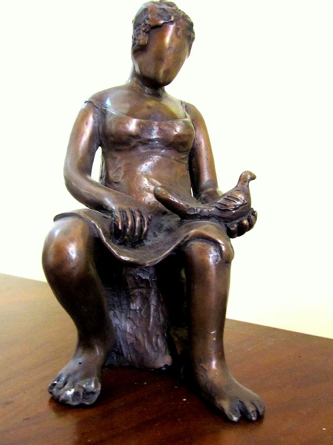 Lady Bird Bronze Sculpture Of A Woman Sitting Holding A Bird With A Dress Face Blurred Strong Legs Sculpture
