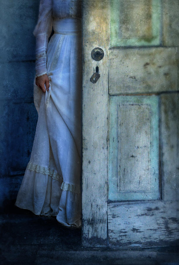 Lady In Vintage Clothing Hiding Behind Old Door Photograph