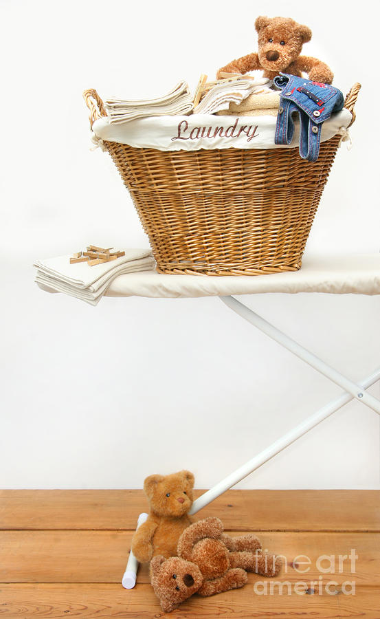 Laundry Basket With Teddy Bears On Floor Photograph