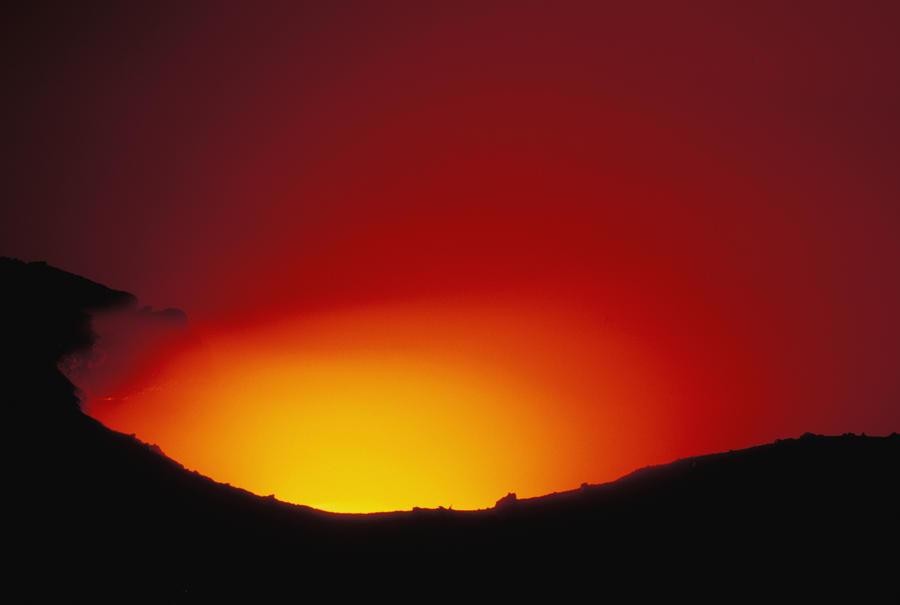 Lava Flows At Night Photograph