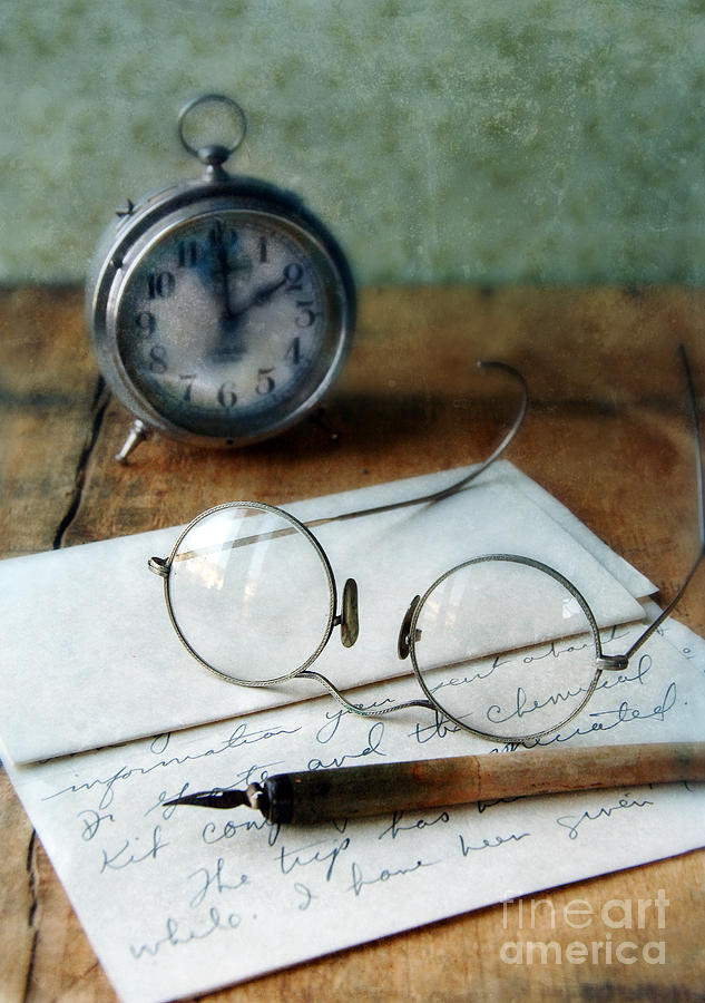 Letter Pen Glasses And Clock Photograph