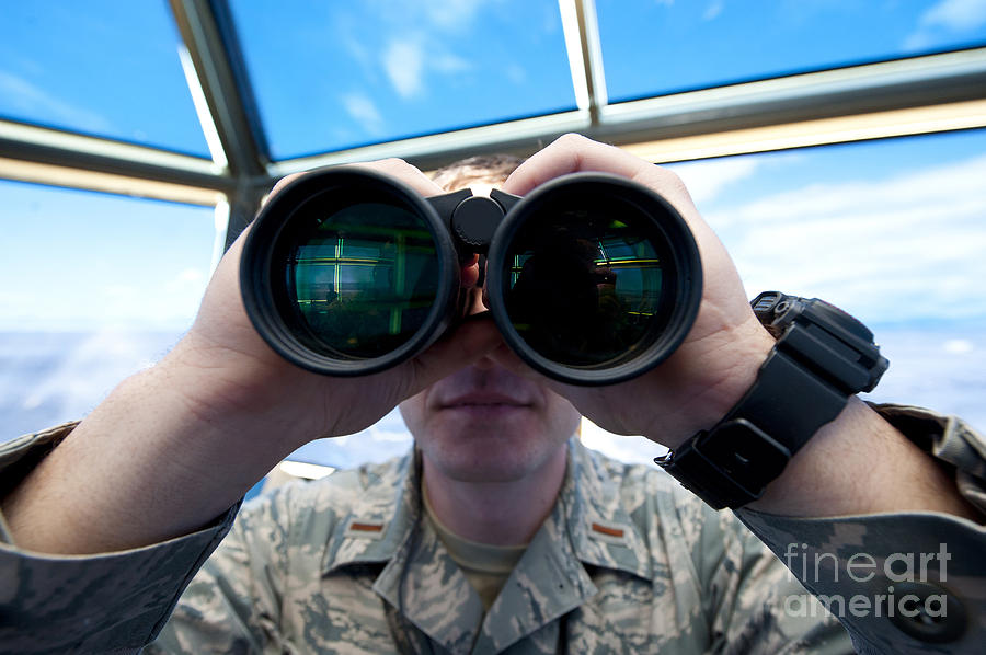 Lieutenant Uses Binoculars To Scan Photograph