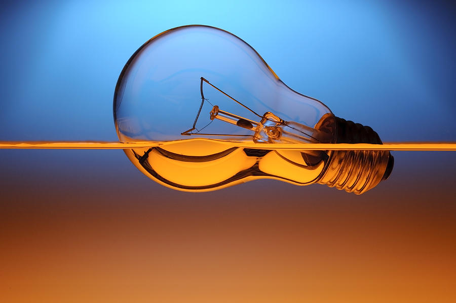 Light Bulb In Water Photograph
