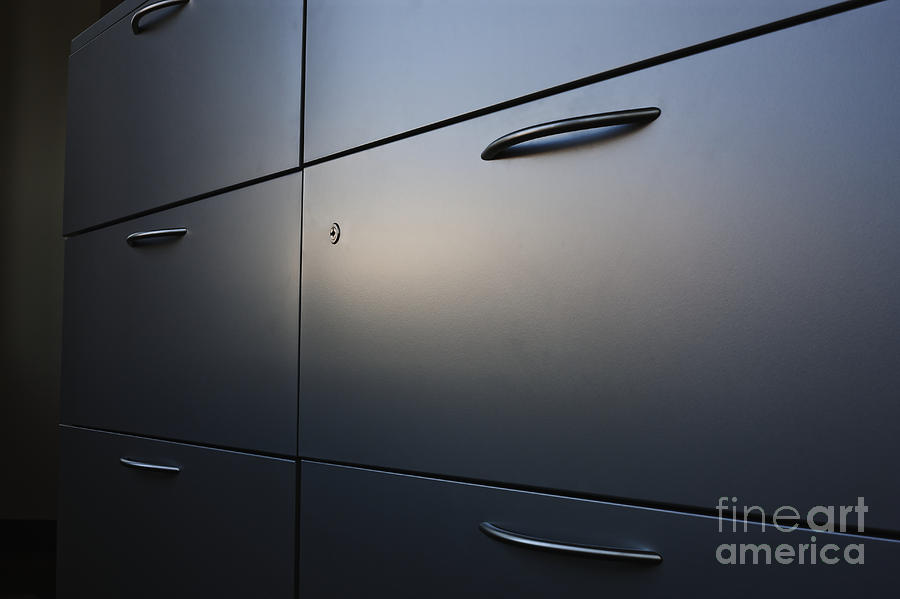 Light Shining On Metal Drawers Photograph