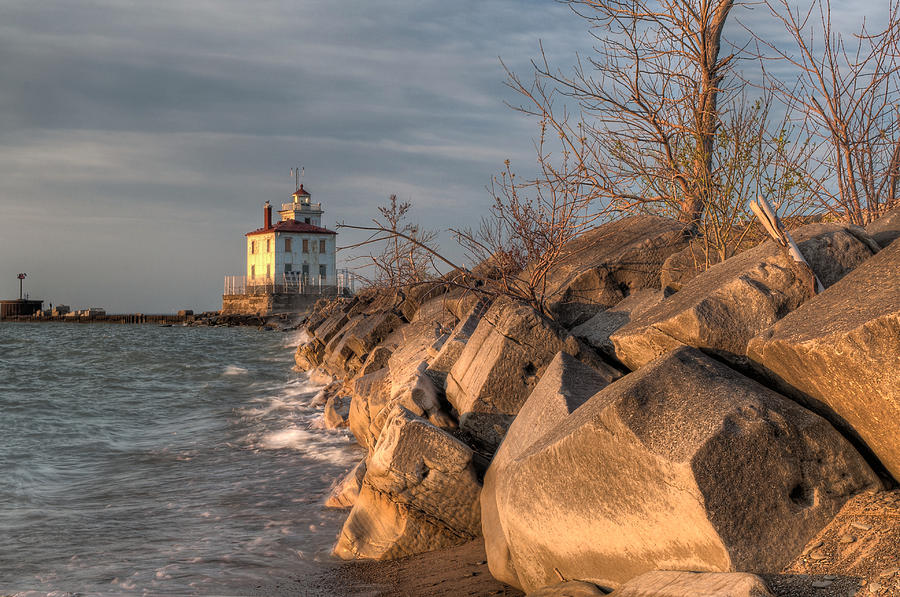 Lighthouse And Breakwall In Evening Light Photograph