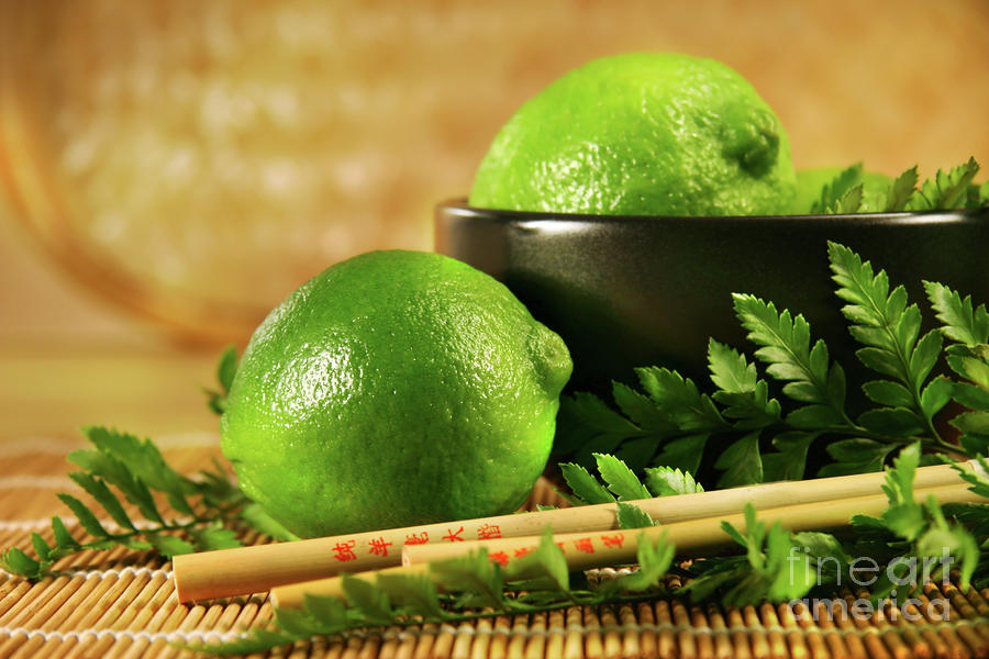 Limes With Chopsticks Photograph