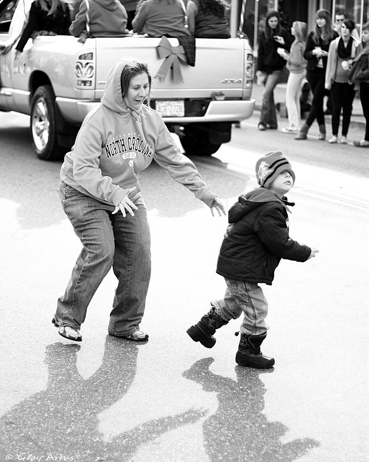 Little Boy Running Out Into To The Road While Mom Tries To Catch Him Photograph