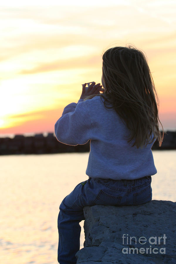 Little Girl Sitting On Rocks Photograph