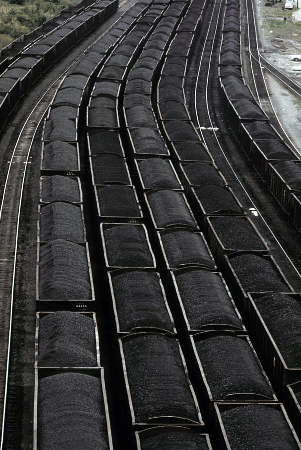 Loaded Coal Cars Sit In The Rail Yards Photograph