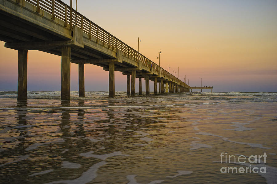 long fishing pier at sunset in port aransas texas