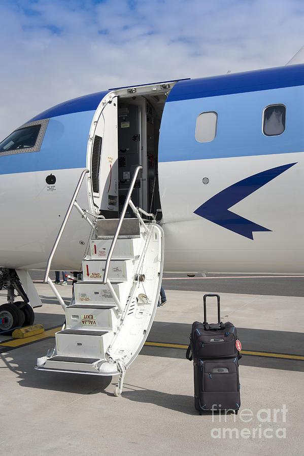 Air Travel Photograph - Luggage Near Airplane Steps by Jaak Nilson