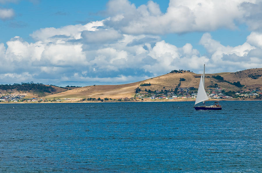 Luxury Yacht Sails In Blue Waters Along A Summer Coast Line Photograph