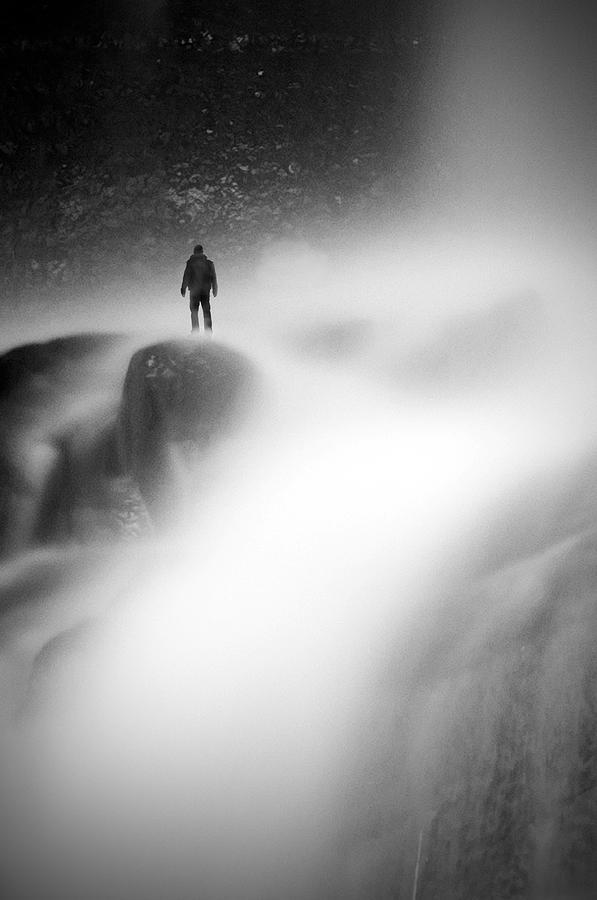 Waterfall Man Black And White Rock Wet Blurry Sweden Swedish Scandinavia  Photograph - Man At Waterfall by Micael  Carlsson