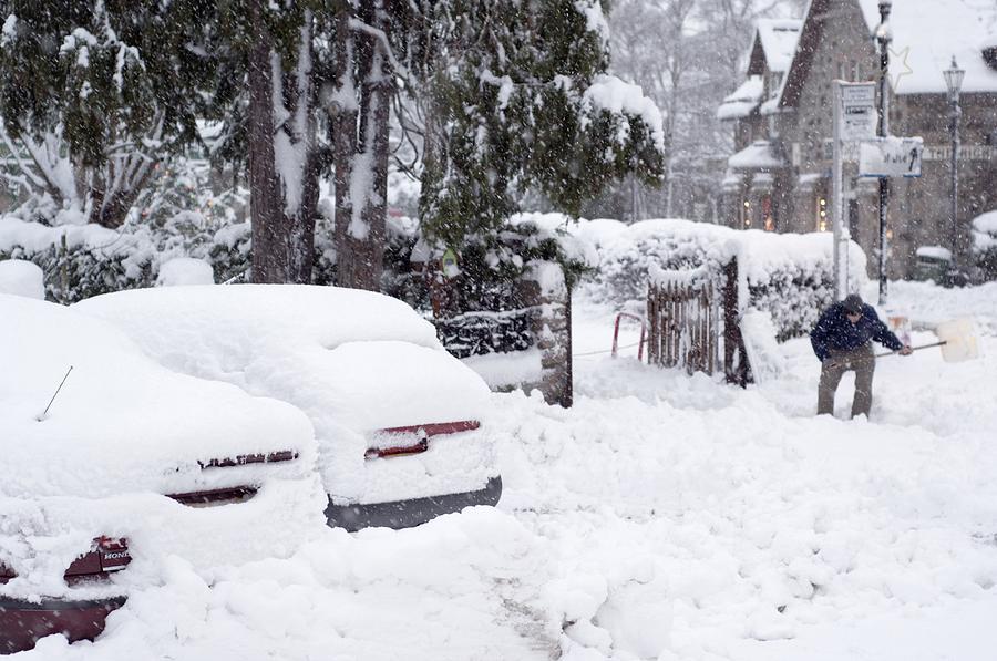 Man Clearing Snow, Braemar, Scotland Photograph