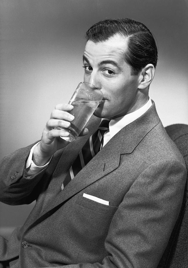 Man Drinking Water From Glass, Posing In Studio, (b&w), Portrait Photograph