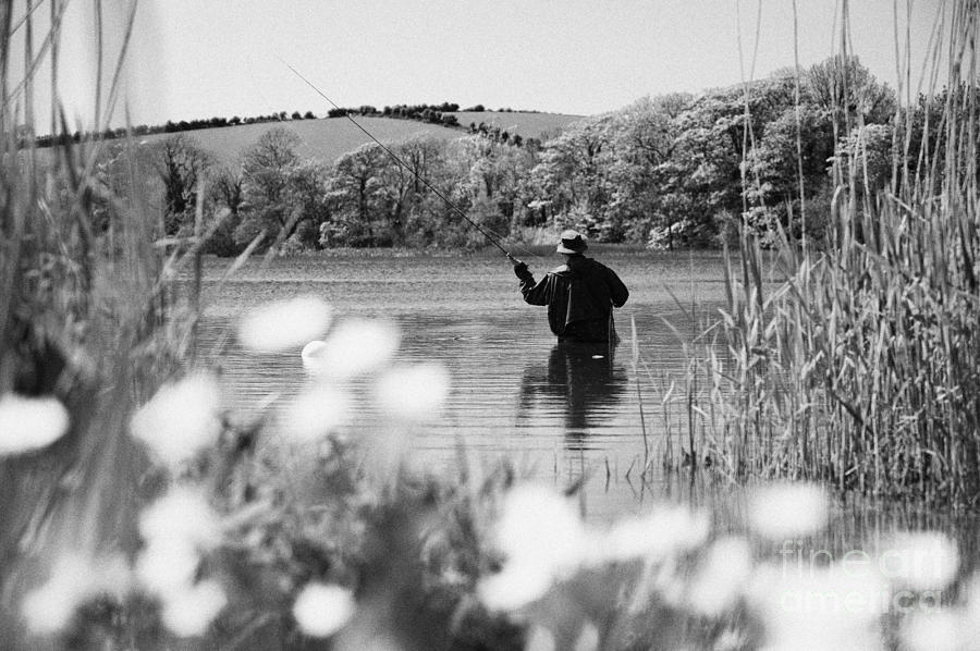Northern Ireland Photograph - Man Flyfishing On Lake In Ireland by Joe Fox